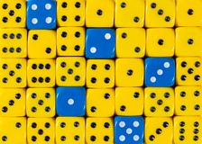 Background of random ordered yellow dices with five blue cubes. Pattern background of random ordered yellow dices with five blue cubes royalty free stock photo