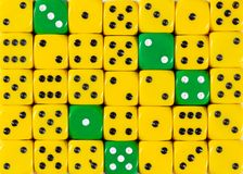 Background of random ordered yellow dices with five green cubes. Pattern background of random ordered yellow dices with five green cubes royalty free stock photography