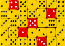 Background of random ordered yellow dices with five red cubes. Pattern background of random ordered yellow dices with five red cubes royalty free stock image