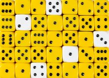 Background of random ordered yellow dices with five white cubes. Pattern background of random ordered yellow dices with five white cubes royalty free stock photo