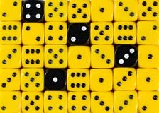 Background of random ordered yellow dices with four black cubes. Pattern background of random ordered yellow dices with four black cubes stock photos