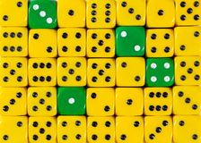 Background of random ordered yellow dices with four green cubes. Pattern background of random ordered yellow dices with four green cubes stock images