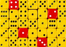 Background of random ordered yellow dices with four red cubes. Pattern background of random ordered yellow dices with four red cubes royalty free stock photo