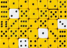 Background of random ordered yellow dices with four white cubes. Pattern background of random ordered yellow dices with four white cubes royalty free stock photos