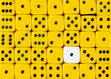 Background of random ordered yellow dices with one white cube. Pattern background of random ordered yellow dices with one white cube stock images