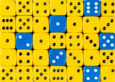 Background of random ordered yellow dices with six blue cubes. Pattern background of random ordered yellow dices with six blue cubes stock images