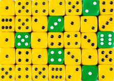 Background of random ordered yellow dices with six green cubes. Pattern background of random ordered yellow dices with six green cubes stock image