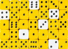 Background of random ordered yellow dices with six white cubes. Pattern background of random ordered yellow dices with six white cubes stock images