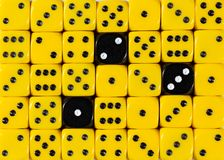 Background of random ordered yellow dices with three black cubes. Pattern background of random ordered yellow dices with three black cubes stock image