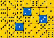 Background of random ordered yellow dices with three blue cubes. Pattern background of random ordered yellow dices with three blue cubes stock images
