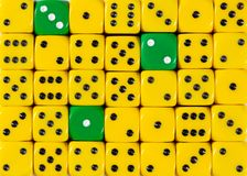 Background of random ordered yellow dices with three green cubes. Pattern background of random ordered yellow dices with three green cubes royalty free stock photo