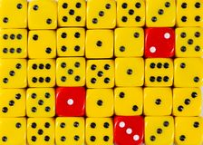 Background of random ordered yellow dices with three red cubes. Pattern background of random ordered yellow dices with three red cubes stock photo