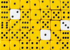 Background of random ordered yellow dices with three white cubes. Pattern background of random ordered yellow dices with three white cubes stock image