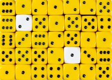 Background of random ordered yellow dices with two white cubes. Pattern background of random ordered yellow dices with two white cubes royalty free stock images
