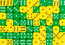 Background of 70 random ordered yellow and green dices. YellowPattern background of 70 random ordered yellow and green dices royalty free stock photography