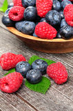 Background of raspberries and blueberries. Background of raspberry and blueberry with a sprig of mint Royalty Free Stock Image