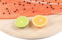Background raw red  fish on wooden board Royalty Free Stock Images