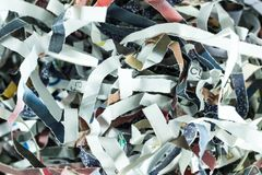 Background of recycle magazine paper shredded. Recycle magazine paper shredded form shredder machine, close up picture Royalty Free Stock Photography
