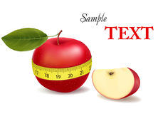Background with red apple measured the meter. Stock Images