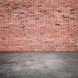 Background with red brick wall and asphalt floor Royalty Free Stock Image