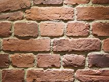 Background brick wall. Background red brick wall closeup Stock Image