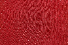 Background of red color fabric with round specks Stock Images