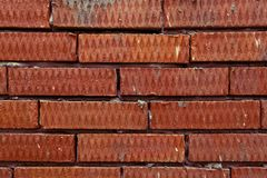 Background of red corrugated textured brick. Background of wall from red corrugated textured brick Royalty Free Stock Photography