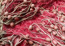 Background of red fishing nets with floats used to fish Stock Photo