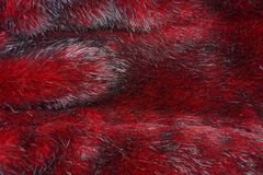 Texture of red fur on a piece of clothing stock image