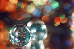 Background red green blue color glass ball reflection bokeh blur. Multicolors background red blue color glass ball reflection bokeh blur textured close-up macro Royalty Free Stock Image