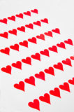 Background of red hearts on white. Royalty Free Stock Images