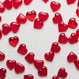 Red hearts on a white wooden substrate. Background of red hearts on a white wooden substrate Royalty Free Stock Photos