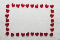 Red hearts on a white wooden substrate. Background of red hearts on a white wooden substrate Royalty Free Stock Image