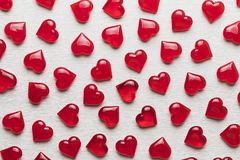Red hearts on a white wooden substrate. Background of red hearts on a white wooden substrate Stock Photos