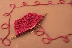 Background with red knitting Stock Photos