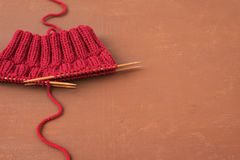 Background with red knitting Stock Photography