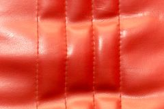 Background of red leather. Photo of an abstract texture Stock Image
