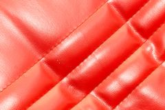 Background of red leather. Photo of an abstract texture Stock Photo