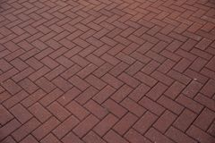 Red paving stones. Pavement cobbled red paving. Background of Red paving stones. Texture. Pavement laid out with red tiles royalty free stock photo