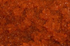 Background - red salmon caviar. Background - brightly red salted salmon caviar closeup stock image