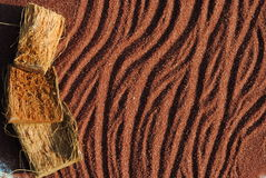 Background of red sand with sticks. Sunset shadows Stock Photo
