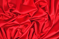 Background from a red satin fabric. With picturesque folds Royalty Free Stock Photo