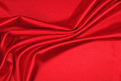 Background from a red satin fabric Royalty Free Stock Photo