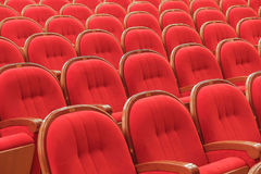 Background of red theatrical red chairs. Background of many red theatrical red chairs Stock Photo