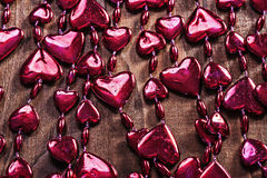 Background red valentines beads garland  on old wooden board hor Stock Image