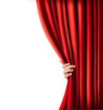 Background with red velvet curtain and hand. Royalty Free Stock Image
