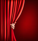 Background with red velvet curtain and hand. Vector illustration Stock Photos