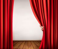 Background with red velvet curtain and hand. Stock Images