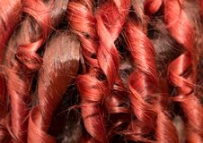 Background of red wavy hair. Photo of an abstract texture Royalty Free Stock Photography