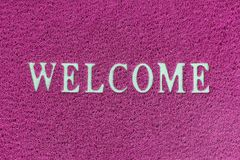 Background of red welcome mat. Background of red welcome carpet stock image